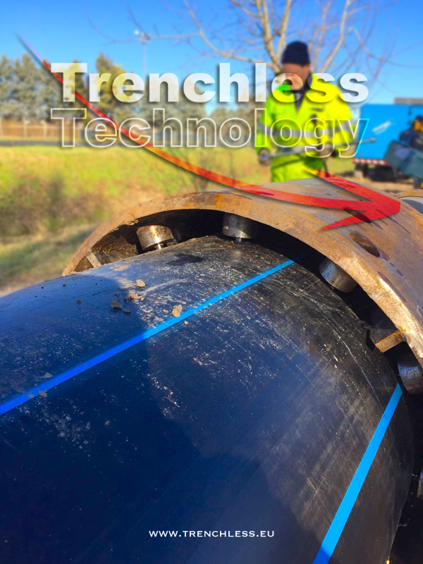 Close-up of the connection between the tail of the expander and the new HDPE pipe